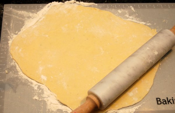 After dough has rested, roll out on to a floured surface to about 1/8th of an inch thick.  It's easier to roll the dough if you roll out only half at a time.