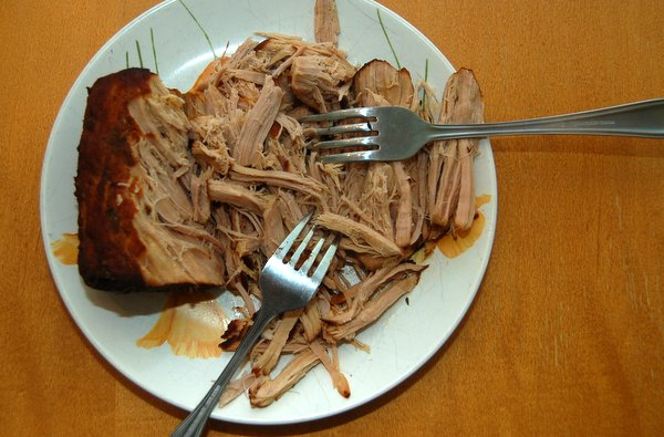 Cover and cook on low setting for 7 to 9 hours until pork is tender.  Remove pork from slow cooker. Allow to stand for a few minutes then shred with two forks.