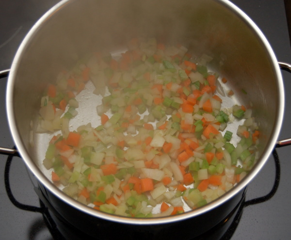 Saute onions, carrots and celery in olive oil until soft and aromatic.