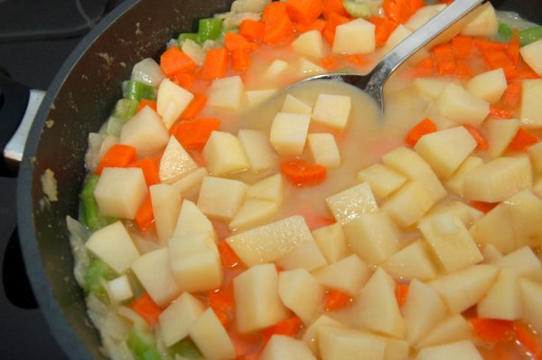 Saute Veggies, sprinkle in flour and add chicken stock.